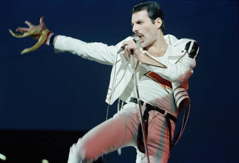 Singer Freddie Mercury of rock band Queen performs on stage at Elland Road football stadium in Leeds, England on May 29, 1982. (Photo by Kevin Cummins/Getty Images)
